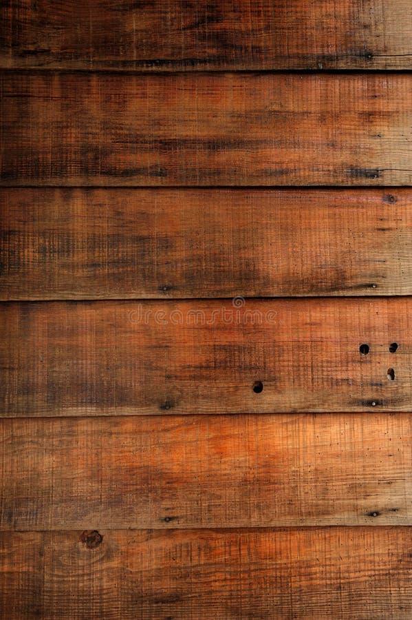 Bevlekte houten muurtextuur als achtergrond stock afbeeldingen