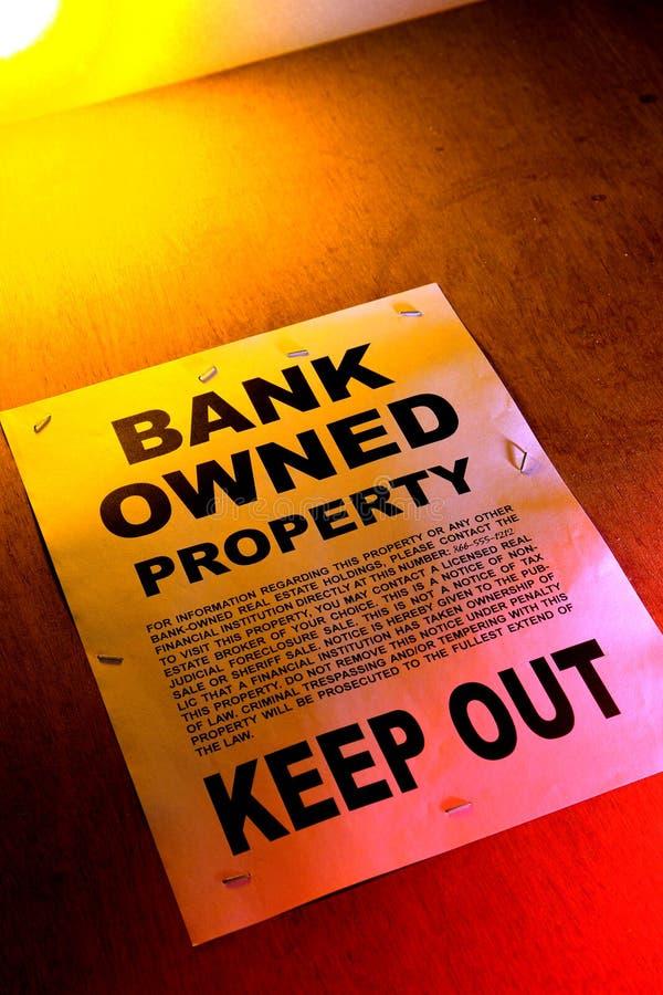Het Bezeten Teken van onroerende goederen Bank bij de Bouw stock foto
