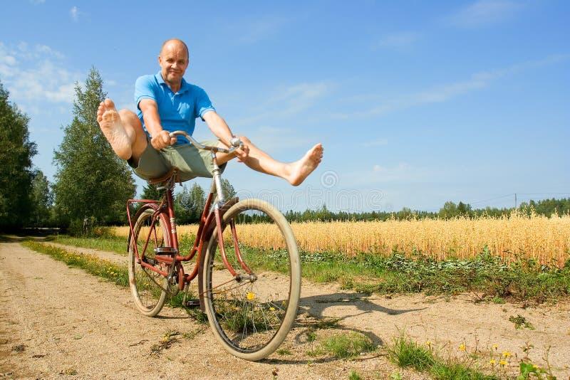 Het bicycling van de mens royalty-vrije stock afbeelding