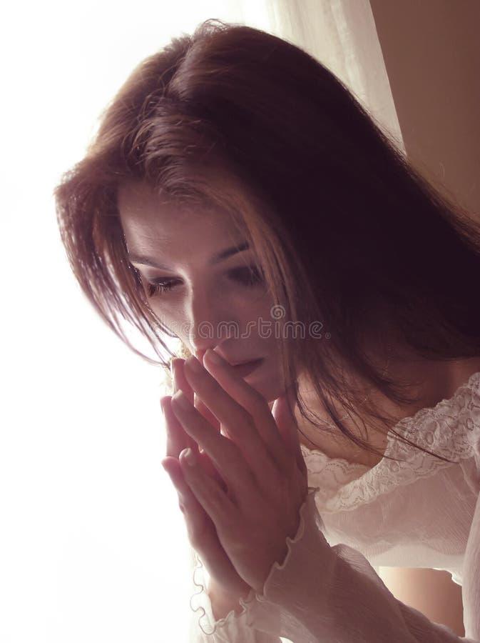 Het bidden van de vrouw royalty-vrije stock fotografie
