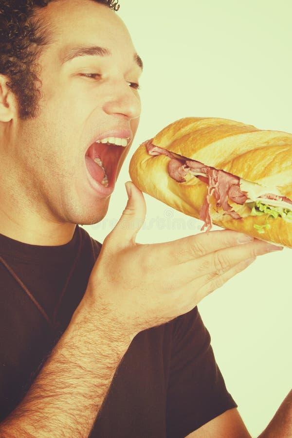 Het Bijten van de mens Sandwich stock foto's