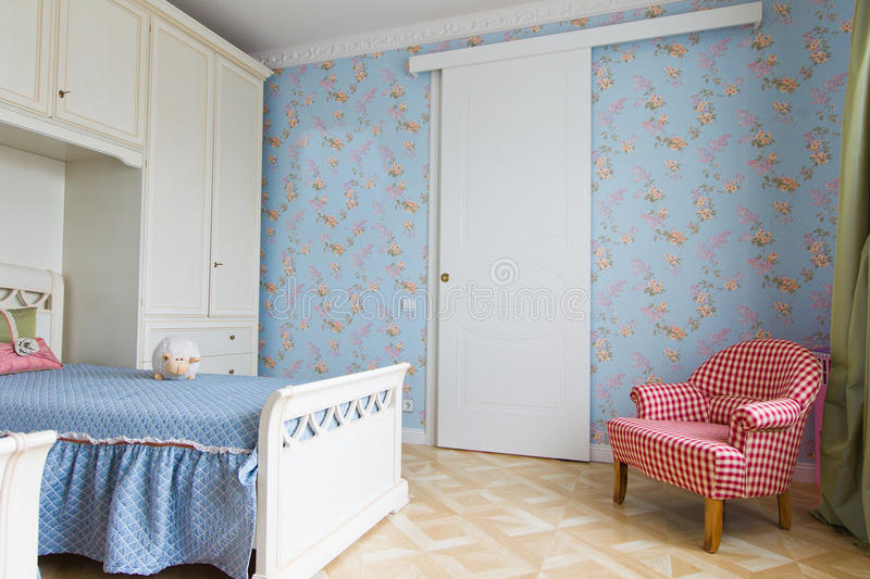 Het blauwe binnenland van de meisjesslaapkamer royalty-vrije stock afbeelding