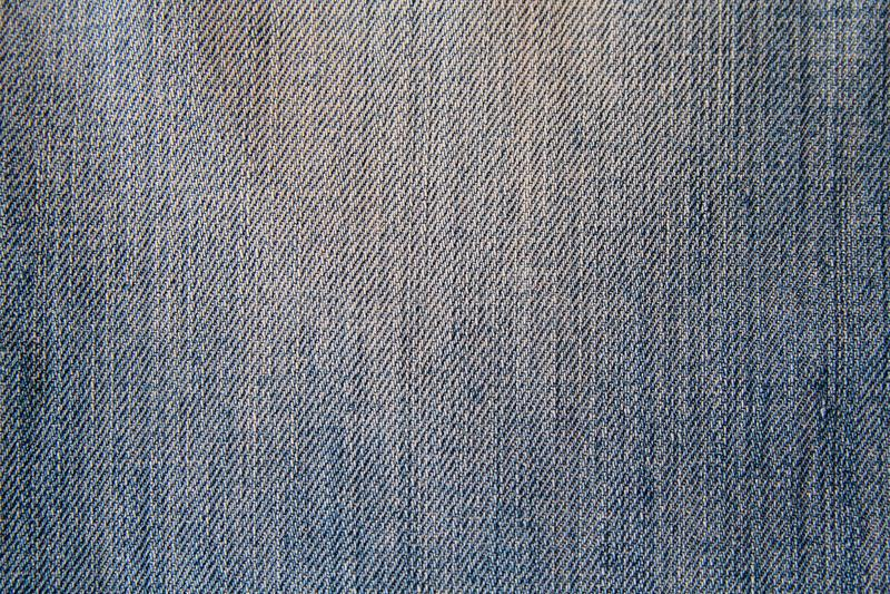 Het blauwe close-up van de denimstof stock afbeeldingen