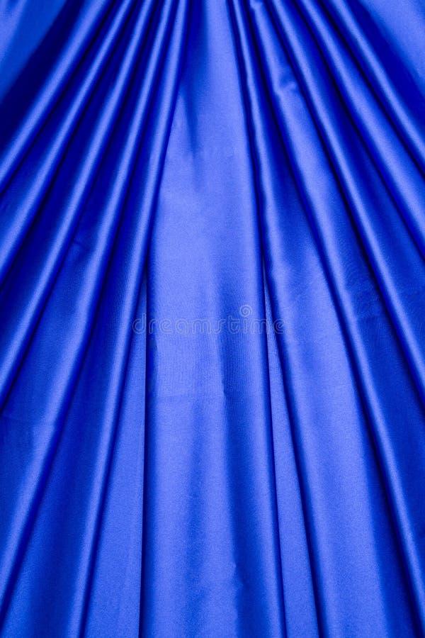 Het blauwe patroon van het satijngordijn stock fotografie