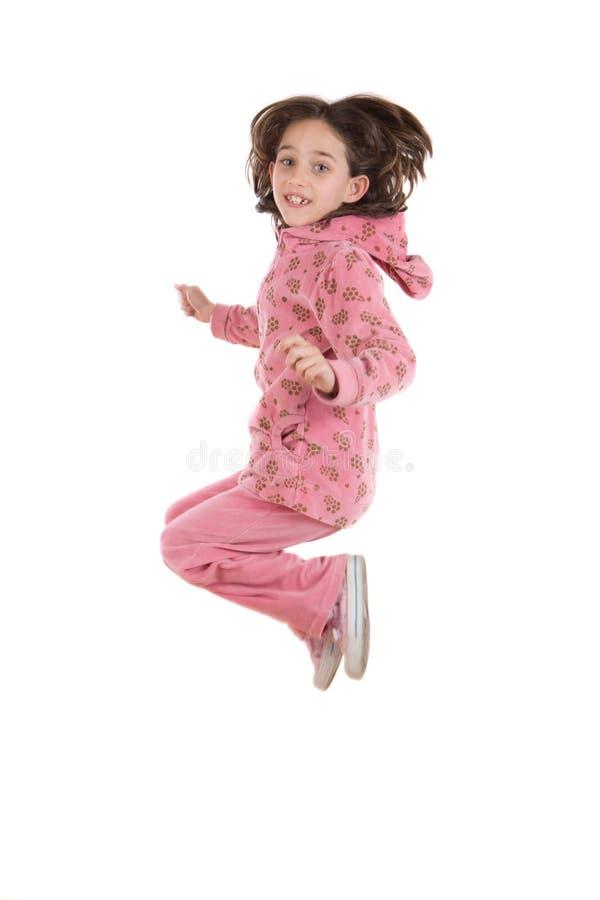 Het blije meisje springen royalty-vrije stock foto's