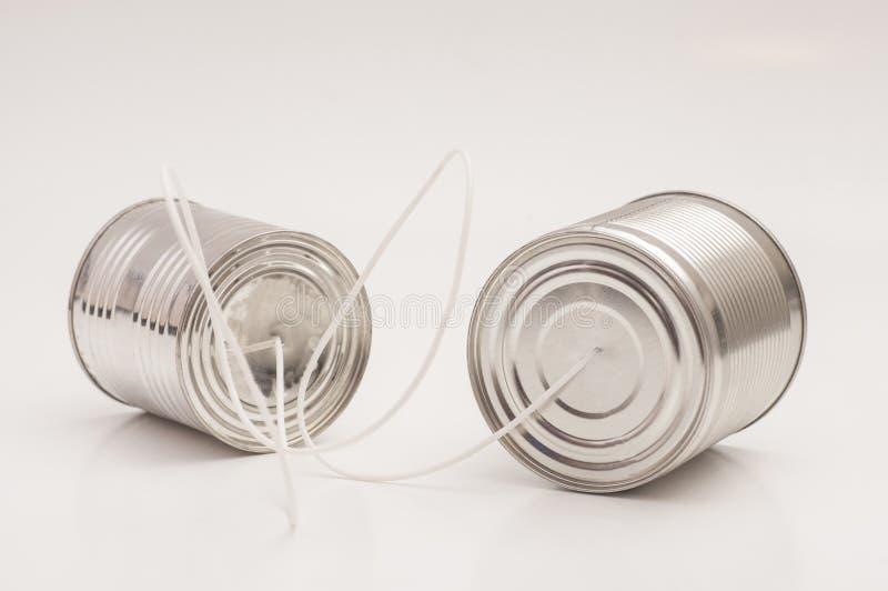 Het blikTelefoon van het tin Communicatie concept stock foto's