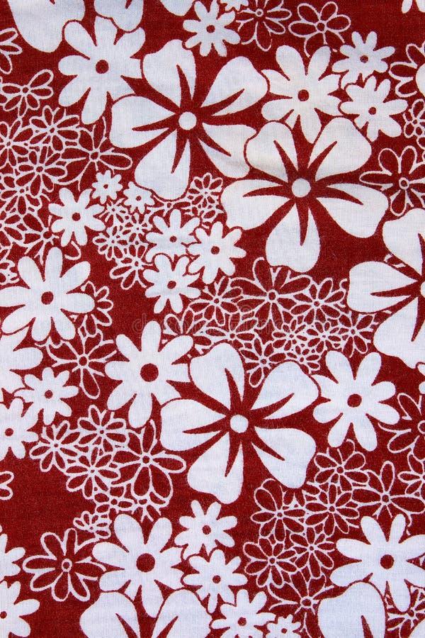 Het bloemenpatroon van de Achtergrondtextuur rode stof royalty-vrije stock afbeeldingen