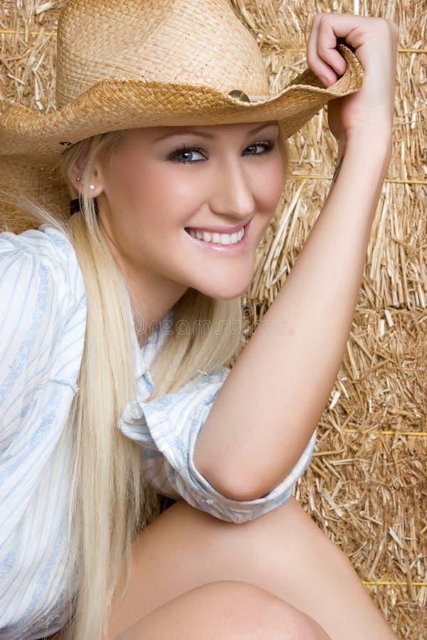 Het blonde Glimlachen van de Veedrijfster royalty-vrije stock afbeeldingen