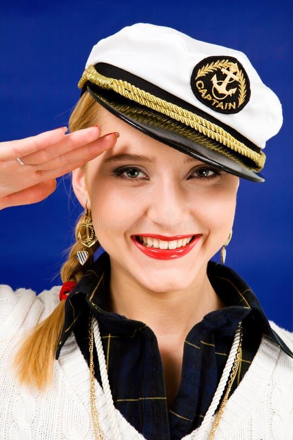 Het blonde jonge vrouw groeten in een overzees piek-GLB royalty-vrije stock foto