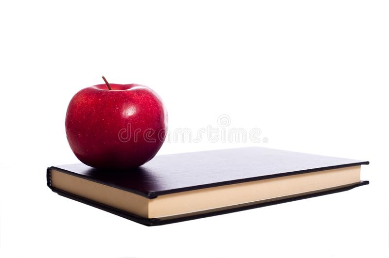 Schoolboek en Apple royalty-vrije stock foto