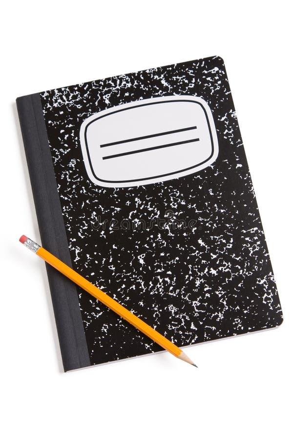 Het boek en het potlood van de samenstelling stock afbeeldingen