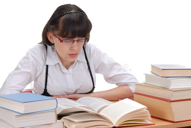Het Boek van de Lezing van het schoolmeisje stock afbeeldingen