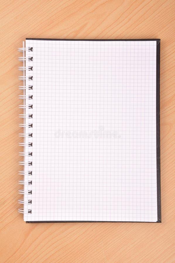 Het boek van de nota stock afbeeldingen