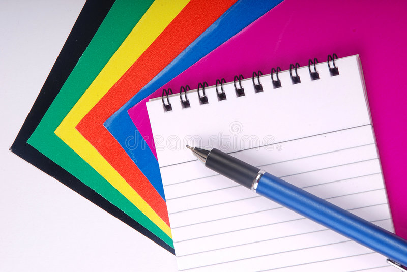Het boek van de nota met pen stock fotografie