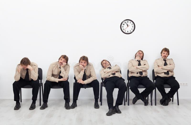 Het Bored mensen wachten royalty-vrije stock fotografie