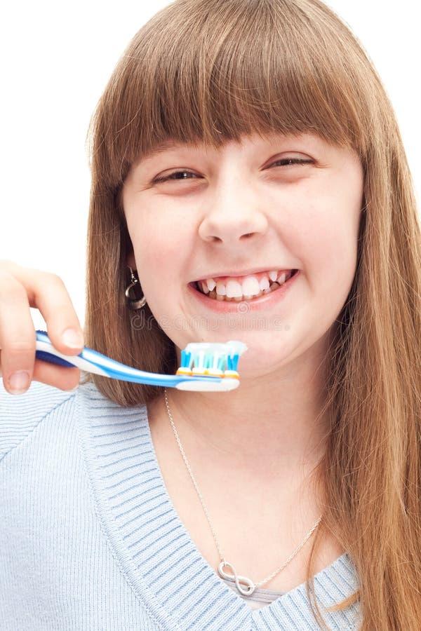 Het borstelen van het meisje tanden royalty-vrije stock afbeelding