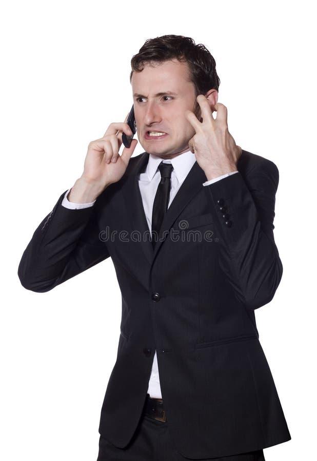 Het boze gillen van de zakenman bij de telefoon stock foto's