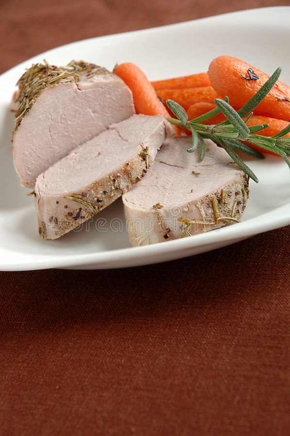 Het Braadstuk en de Wortelen van het varkensvlees stock afbeeldingen