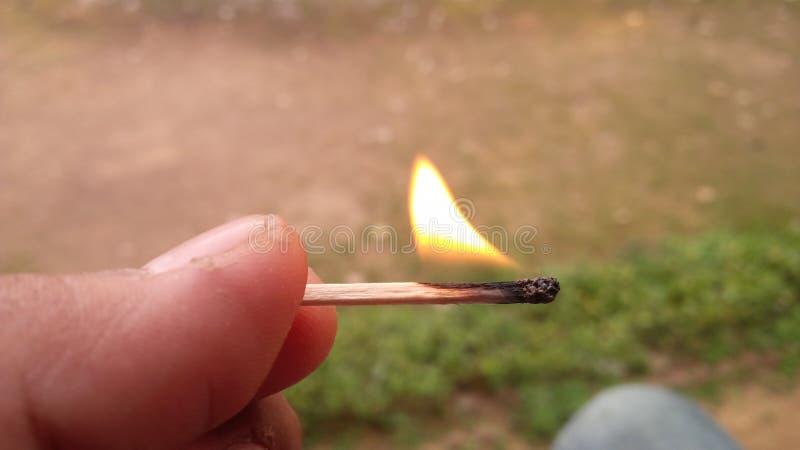 Het branden matchstick op hand royalty-vrije stock fotografie
