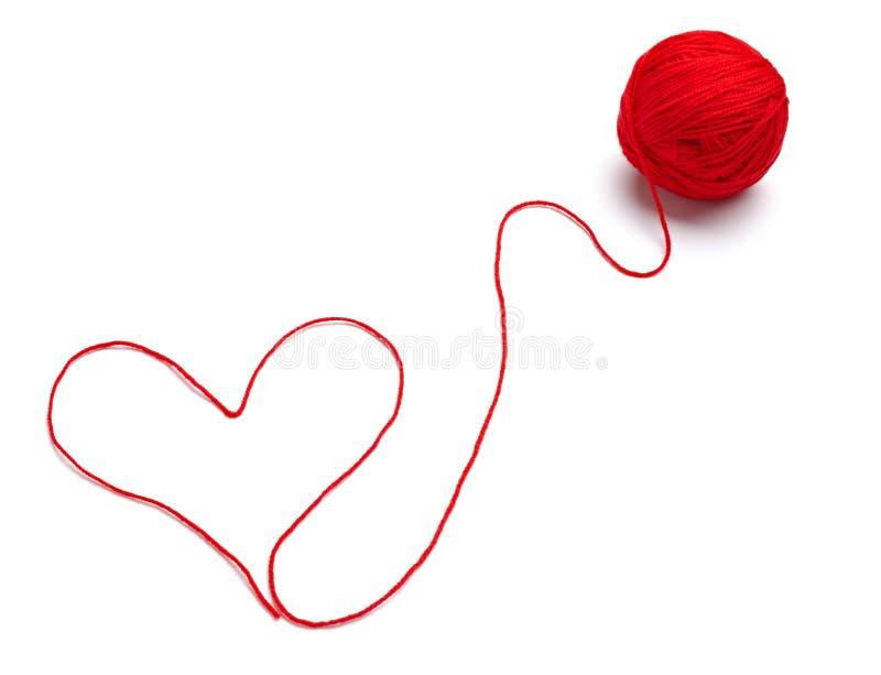 Het breien van de wol hartvorm stock fotografie