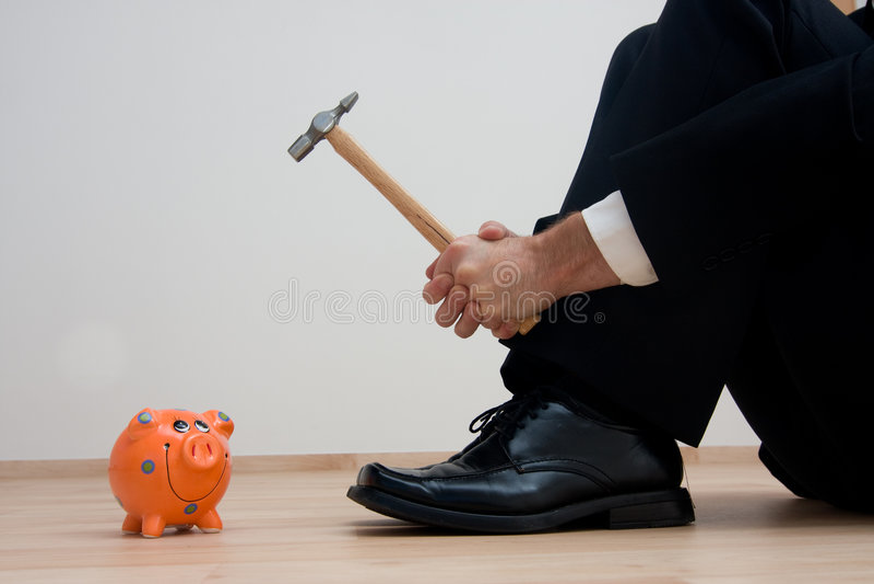 Het breken van Piggybank royalty-vrije stock foto's