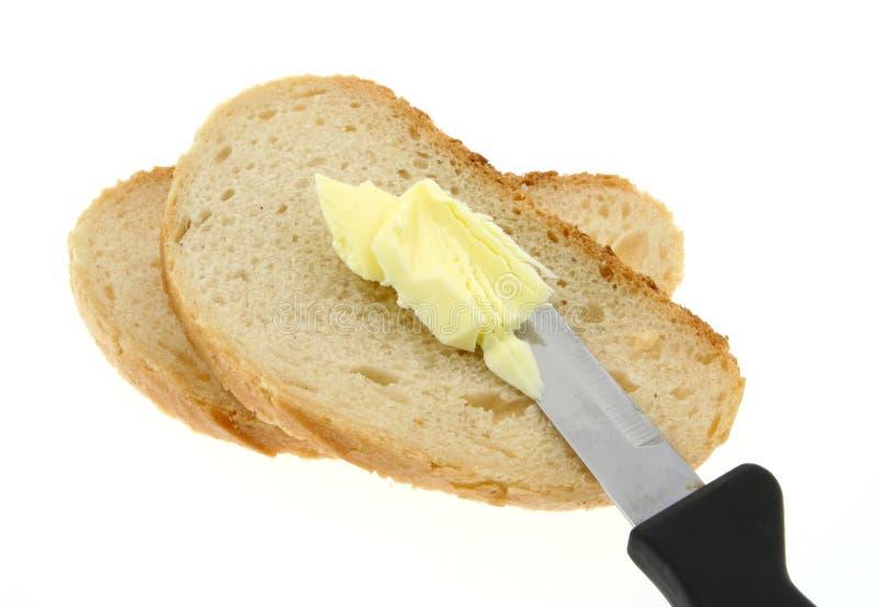 Het brood van Buttering stock afbeelding