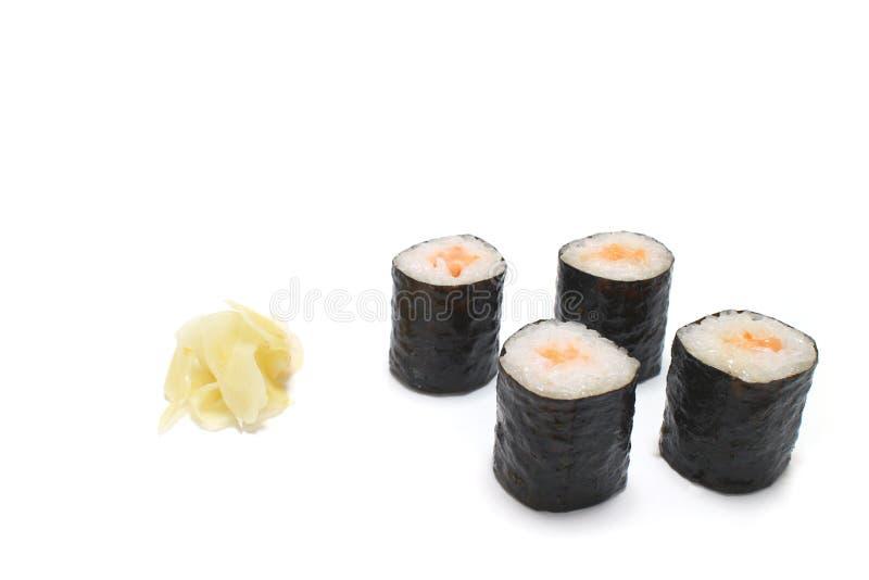 Het broodjesassortiment van zalmsushi in het wit stock afbeelding