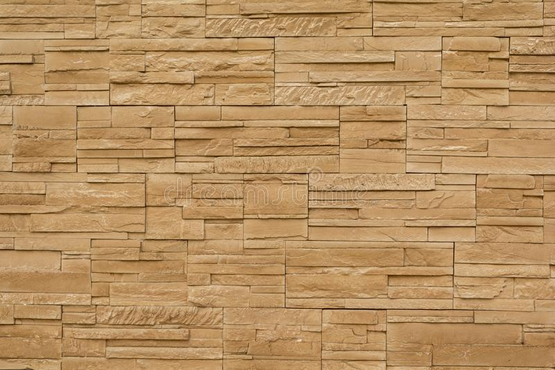 Het bruine patroon van de steenmuur, sluit omhoog stock fotografie