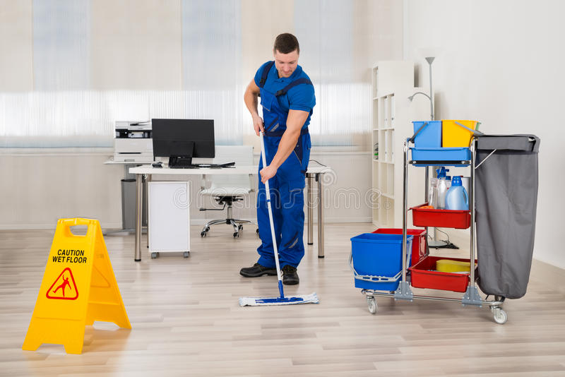 Het Bureau van portiermopping floor in stock foto