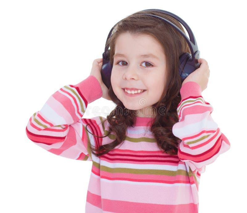 Het charmante meisje luistert aan muziek. stock afbeelding