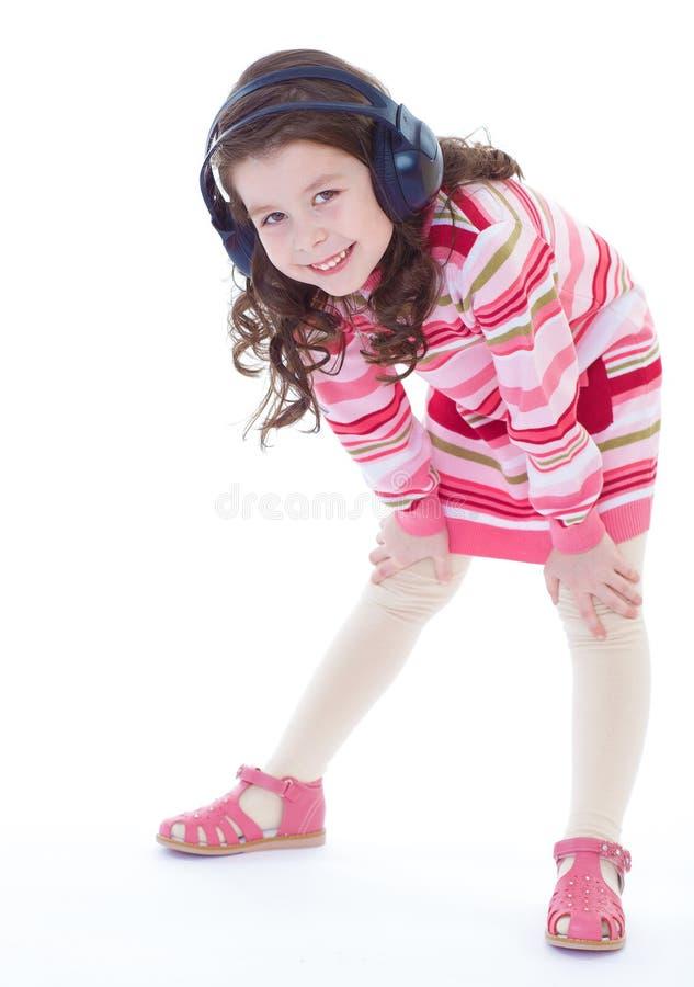 Het charmeren en zeer het muzikale meisje dansen. stock afbeeldingen