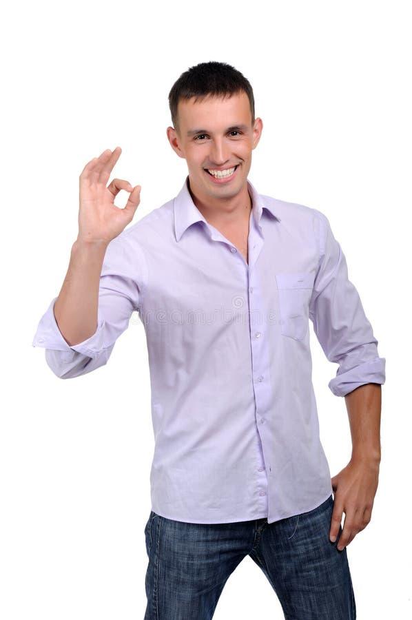 Het charmeren van de jonge mens in jeans stock afbeelding