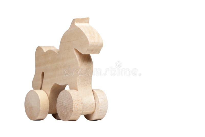 Het cijferontwerp van het Minimalistic klein houten paard op wielen, concept trojan paard en ellende of eenvoudig ge?soleerd chil stock afbeeldingen