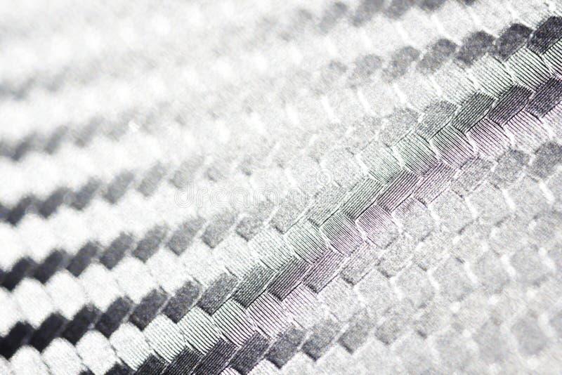 Het Close-up van de het Weefseltextuur van de koolstofvezel stock afbeeldingen