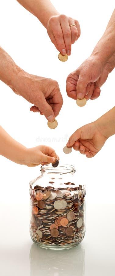 Het concept van de besparing met handen van verschillende generaties stock afbeelding