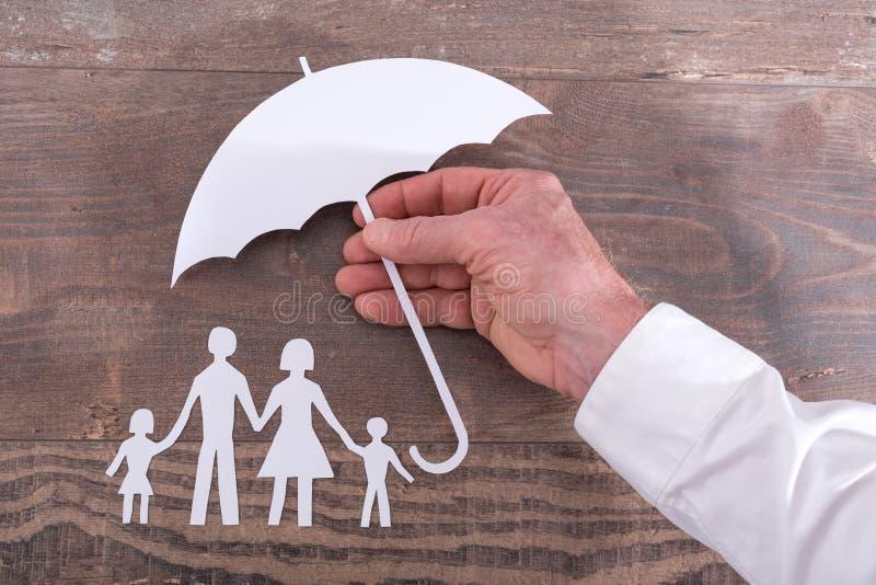 Het concept van de familieverzekering stock afbeeldingen