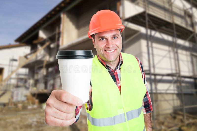Het concept van de het werkonderbreking met aannemer en koffiekop royalty-vrije stock foto