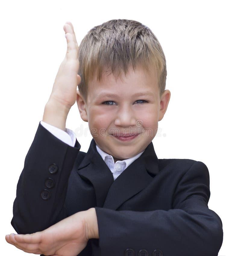 Het concept van de school De jongen hief zijn hand op stock fotografie