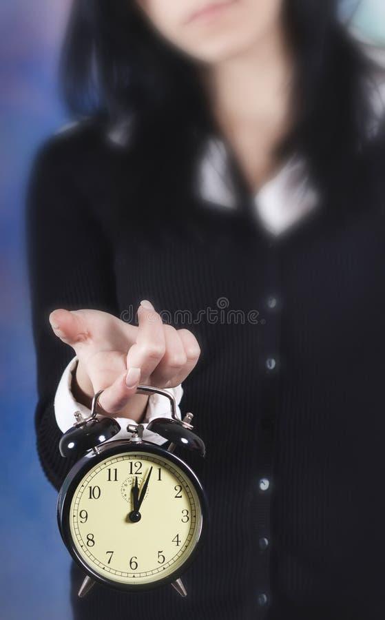 Het concept van de tijd. Bedrijfs vrouwenklok royalty-vrije stock afbeelding