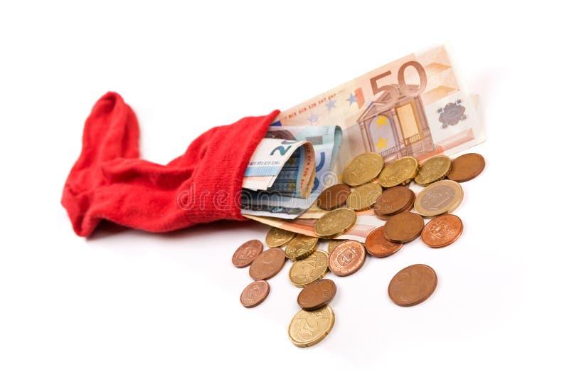 Het concept van geldbesparingen - sokhoogtepunt van geld op wit royalty-vrije stock foto