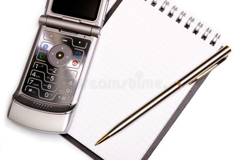 Het concept van kantoorbenodigdheden - spiraalvormig notitieboekje, pen en moderne telefoon stock foto's