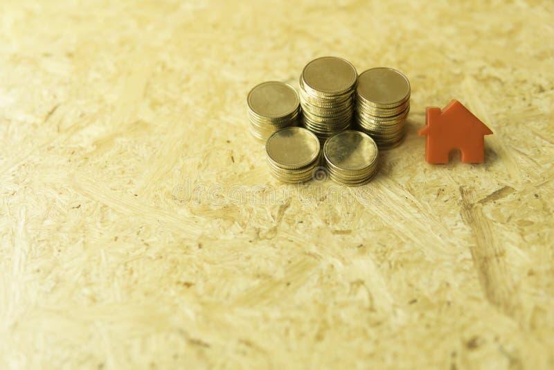 Het concept van het muntstukkenhuis stock afbeeldingen