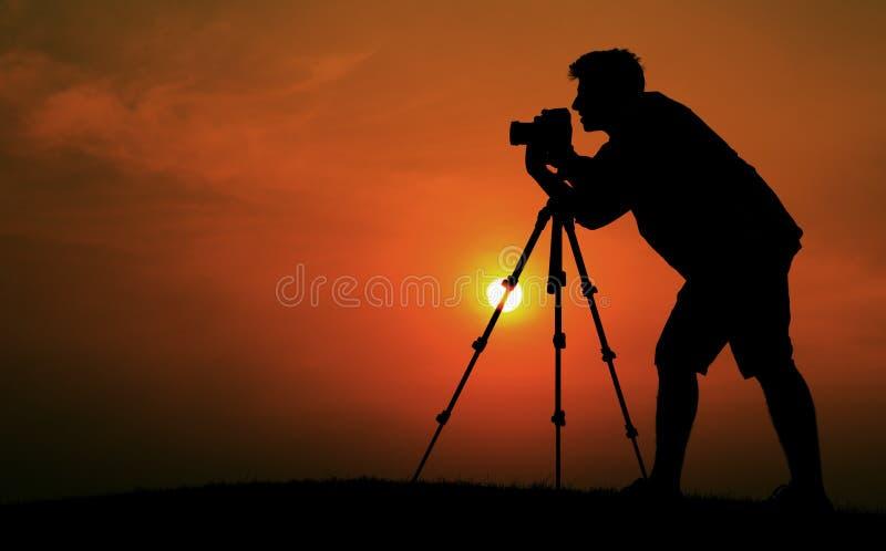 Het Concept van Taking Pictures Silhouette van de mensenfotograaf stock foto's