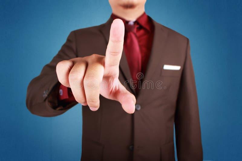 Het Concept van zakenmanpressing virtual button royalty-vrije stock afbeelding