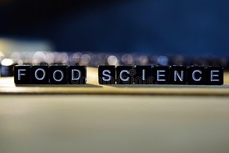 Het concepten houten blokken van de VOEDSELwetenschap op de lijst stock fotografie