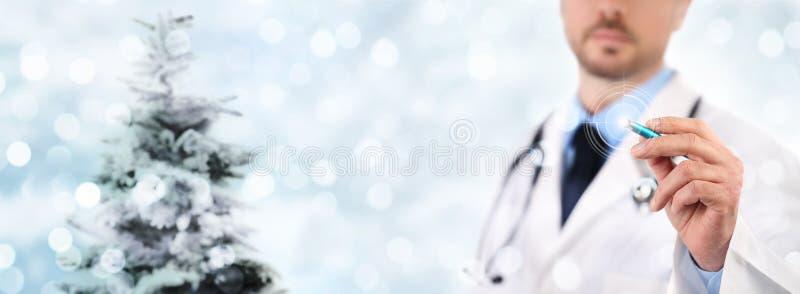 Het conceptenhand van de Kerstmis het medische partij scherm van de artsenaanraking met pe royalty-vrije stock fotografie