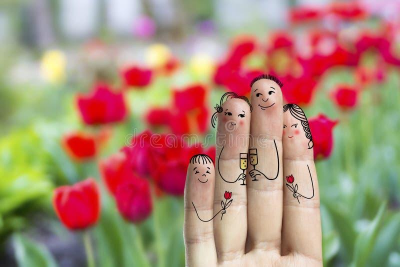 Het conceptuele art. van de familievinger De vader, de zoon en de dochter vieren hun mother'sdag stock afbeeldingen