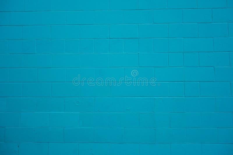 Het concrete geschilderde turkooise blauw van het sintelblok muur royalty-vrije stock foto's