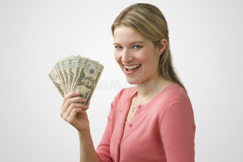 Het Contante geld van de Holding van de vrouw stock afbeeldingen