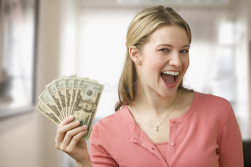Het Contante geld van de Holding van de vrouw royalty-vrije stock foto